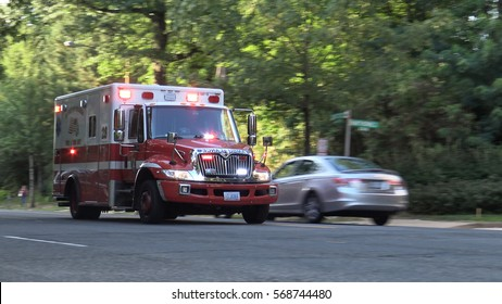 WASHINGTON, DC - JULY 2015: Fire Department ambulance responding, leafy. DC EMS is part of Washington Fire Department - DC FEMS,