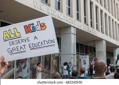 WASHINGTON, DC - JULY 22, 2017: Marchers in National March for Public Education march to Department of Education Building, protesting cuts in federal funds and the expanding private-school vouchers.