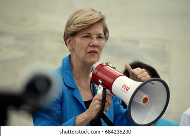 WASHINGTON, DC -- JULY 25 2016: Senator Elizabeth Warren addresses crowds outside the Capitol protesting the GOP health bill.