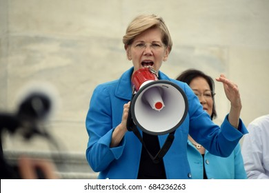 WASHINGTON, DC -- JULY 25 2016: Senator Elizabeth Warren addresses crowds outside the Capitol protesting the GOP health bill.