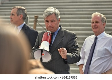 WASHINGTON, DC -- JULY 25 2017: Senator Sheldon Whitehouse addresses a crowd of supporters from the steps of the US Capitol after the senate vote on the motion-to-proceed for the Trumpcare bill.
