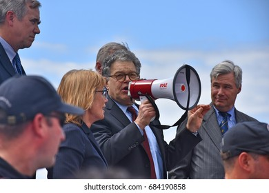 WASHINGTON, DC -- JULY 25 2017: Senator Al Franken addresses a crowd of supporters from the steps of the US Capitol after the senate vote on the motion-to-proceed for the Trumpcare bill.