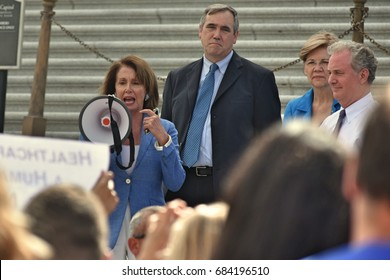 WASHINGTON, DC -- JULY 25 2017: Nancy Pelosi addresses a crowd of supporters at a rally on the Capitol steps after the motion to proceed vote on the Trumpcare bill.