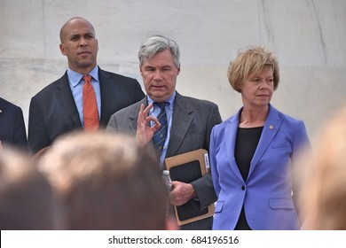 WASHINGTON, DC -- JULY 25 2017: Democratic senators address a crowd of supporters at a rally on the Capitol steps after the motion to proceed vote on the Trumpcare bill.