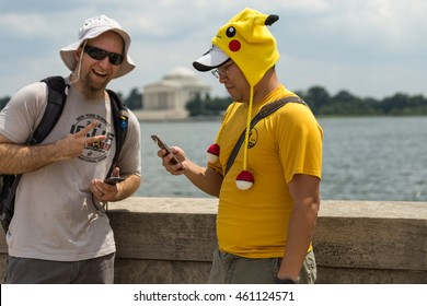 Washington, D.C - July 30:  Two Team Instinct Pokemon Go! players pause in front of the Tidal Basin and Jefferson Memorial to catch a Pokemon