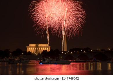 Washington DC July 4, 2018: Fireworks over the Washington Monument and Lincoln Memorial on July 4, 2018. Reflection of fireworks visible in the Potomac.