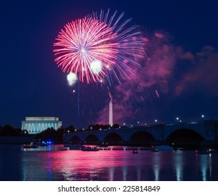 WASHINGTON, DC - JULY 4: Fireworks appear over the Washington Monument and Lincoln Memorial on July 4, 2014 in Washington, DC.