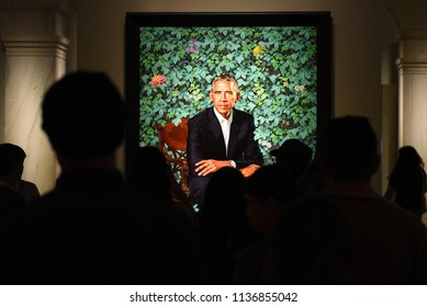 Washington, DC - June 01, 2018: People near the portrait of the 44th president of the United States Barack Obama by Kehinde Wiley in National Portrait Gallery in DC.