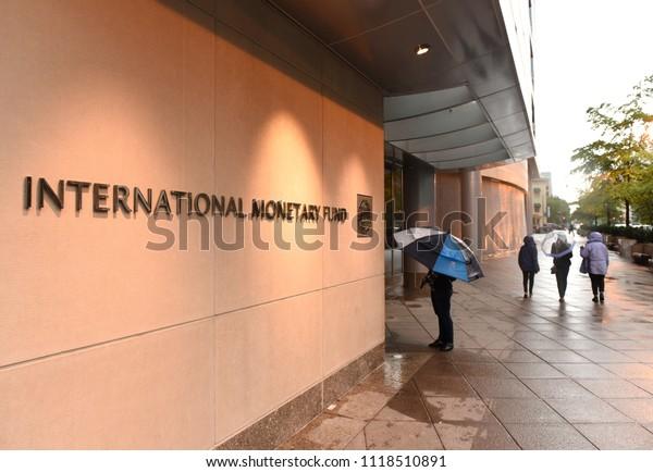 Washington, DC - June 04, 2018: People near the International Monetary Fund, IMF Headquarters 2 Building (HQ2) in DC.