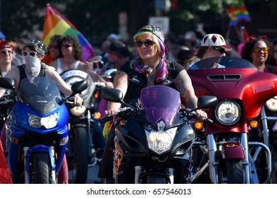 WASHINGTON, DC – JUNE 10 2017: A biker rides in the Capital Pride Parade.