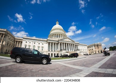 WASHINGTON, D.C. - JUNE 11, 2014: Government vehicles parked in front of The Capitol. It is the seat of the United States Congress.