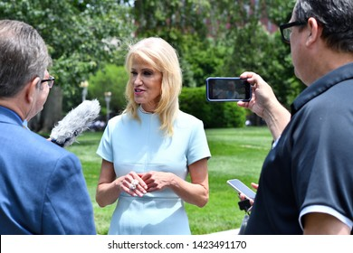 """WASHINGTON, DC - JUNE 12, 2019: Kellyanne Conway, counselor to President Trump """"gaggles"""" with reporters in the White House driveway."""