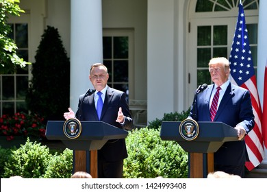 WASHINGTON, DC - JUNE 12, 2019: President Andrzej Duda of Poland address reporters at a joint press conference in the Rose Garden of The White House while President Donald Trump listens.