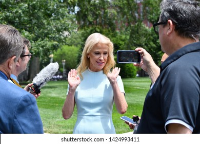 WASHINGTON, DC - JUNE 12, 2019: Kellyanne Conway, counselor to President Trump addresses reporters questions in the White House driveway.