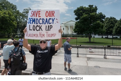 WASHINGTON, DC - JUNE 17, 2018: Protester at White House with sign suggesting a way to save our democracy from the President Trump's coziness with certain dictators.