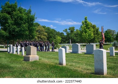 WASHINGTON, D.C. - JUNE 20, 2014: Honor Guard at Arlington National Cemetery marching behind caisson carrying casket to grave site. Arlington National Cemetery was established in 1864.