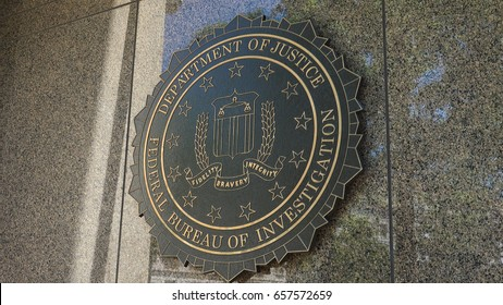 WASHINGTON, DC - JUNE 2017: Close on Seal of FBI on Federal Bureau of Investigation headquarters building ion Pennsylvania Ave.  Named the J. Edgar Hoover Building after the first FBI director.