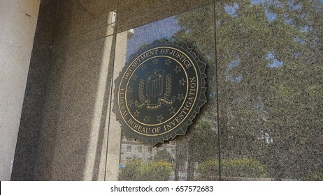 WASHINGTON, DC - JUNE 2017: Seal of FBI on Federal Bureau of Investigation headquarters building ion Pennsylvania Ave.  Named the J. Edgar Hoover Building after the first FBI director.