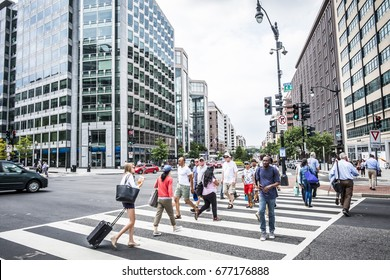 Washington DC, June 2017, United States: a crowd of people crossing a city street at the pedestrian crossing in downtown Washington DC