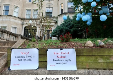 "WASHINGTON, DC - JUNE 22, 2019: EMBASSY OF THE SUDAN - signs placed at entrance - ""SORRY! SUDANESE BLOOD IS NOT FOR SALE"" - ""KEEP OUT OF SUDAN! FREEDOM IS HIGHLT CONTAGIOUS"""