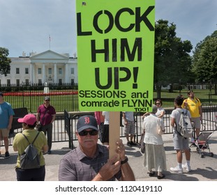 WASHINGTON, DC - JUNE 25, 2018; Anti-Trump protester at White House with placard expressing popular, possibly inevitable, sentiment - Lock Him Up. Tourists nearby.