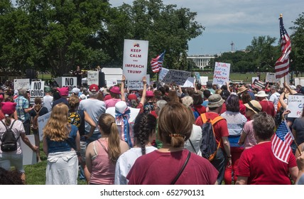 WASHINGTON, DC - JUNE 3, 2017: Participants in  March for Truth listen to Linda Sarsour imploring them to remain active in fight against Donald Trump and his collusion with Russia. White house in b.g.