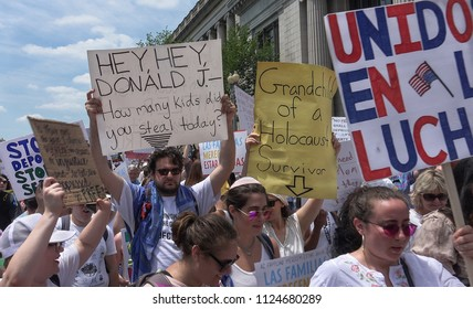 WASHINGTON, DC - JUNE 30, 2018: Protesting Trump's immigration policy & family detention and separation, thousands march from rally near White House to the Justice Department. Families Belong Together