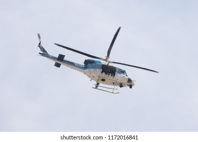 WASHINGTON, DC - JUNE 30, 2018: United States Park Police Helicopter flies above Federal Triangle to photograph a crowd of protesters marching along Pennsylvania Avenue towards the U.S. Capitol.