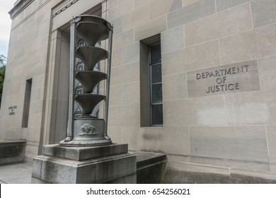 WASHINGTON, DC - JUNE 4, 2017: Department of Justice headquarters  building, one of many entrances with 20-foot high aluminum door; Art Deco torchere, Washington, DC
