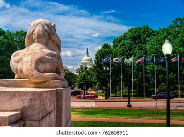 Washington DC - June 6, 2017: View from Union Station at Columbus Circle to the US Capitol building in Washington D.C. -  Big Lion sculpture in front.