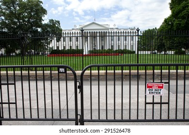 WASHINGTON, DC - JUNE 6: The White House and fences along Pennsylvania Avenue in Washington, DC on June 6, 2015. The second lower fence was added to deter people from jumping the original fence.