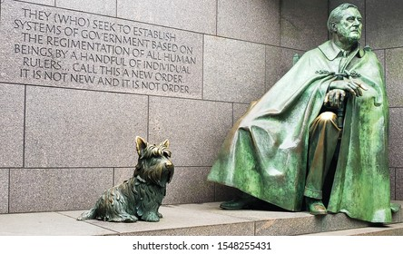 Washington D.C. June 7th 2019 Bronze statue by Neil Estern of  Franklin D Roosevelt sitting down in a cape and his dog Fala - Franklin Delano Roosevelt Memorial.