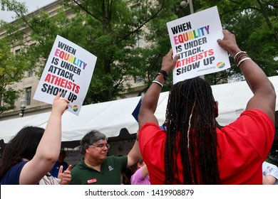WASHINGTON, DC - JUNE 9, 2019:  - CAPITAL PRIDE - signs - WHEN EQUALITY IS UNDER ATTACK, ATHEISTS SHOW UP
