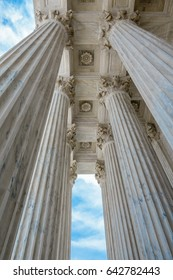 Washington, DC - Low angle view of the columns of the United States Supreme Court with blue sky.