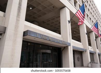 WASHINGTON, DC - MARCH 14, 2018: Front facade of the J. Edgar Hoover FBI Building in Washington DC DC - MARCH 14, 2018: Front facade of the J. Edgar Hoover FBI Building in Washington DC