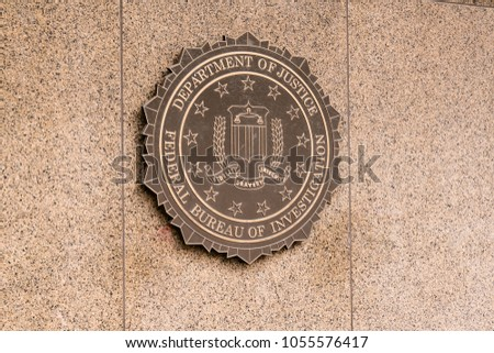 WASHINGTON, DC - MARCH 14, 2018: Seal of the Federal Bureau of Investigation on the J. Edgar Hoover FBI Building in Washington, DC