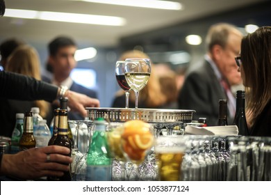 Washington, DC - March 15, 2018: Drinks are served at a corporate networking event in an office building.