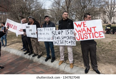 WASHINGTON, DC - MARCH 15, 2019: Dozens of Yezidis (Yazidis) living in the US demonstrate at the White House to draw attention to the ongoing genocide and abduction of Yezidis by ISIS (ISIL) in Iraq.