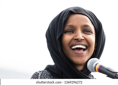 WASHINGTON, D.C. - MARCH 15, 2019: Rep. Ilhan Omar (D-MN) smiles to the crowd during her address to the crowd at the 2019 Youth Climate Strike in Washington D.C.