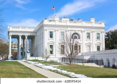 Washington, DC – March 17, 2017: Snow lies on the White House lawn as US President Donald Trump waits for German Chancellor Angela Merkel's arrival. Their meeting was rescheduled due to snow.