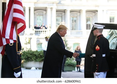 Washington, DC – March 17, 2017: US President Donald J. Trump greets German Chancellor Angela Merkel as she arrives at the White House for their first in-person meeting.
