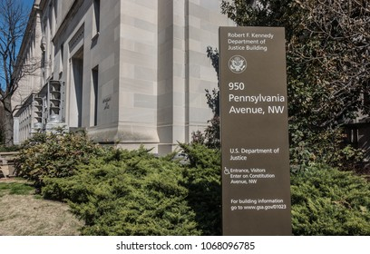 WASHINGTON, DC - MARCH 2018: Headquarters of the U.S. Justice Department.  Art Deco aluminum torcheres at doorway.  Renamed the Robert F. Kennedy Department of Justice Building in 2001.