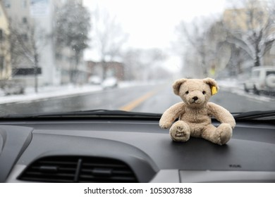 Washington, DC - March 21, 2018: A Steiff brand teddy bear sits on the dashboard of a car.