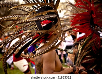 WASHINGTON DC - MARCH 21: Group demonstrates native aztec dance in traditional garb at the pro-illegal immigration march in Washington DC, March 21 2010.