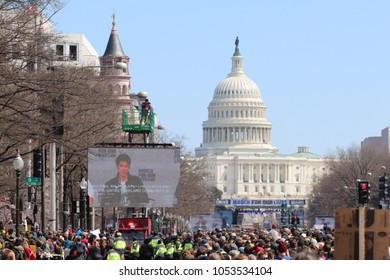 WASHINGTON, DC - MARCH 24 2018: Participants and signs on Pennsylvania Avenue in the United States capital city at the March for our Lives rally in Washington, DC on March 24, 2018.
