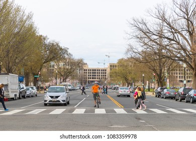 Washington DC March 31 2018: People on busy Avenue in downtown.