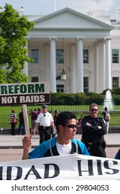 WASHINGTON, DC - MAY 1: Immigrants and their supporters march to the White House on International Workers' Day, to call for legal reforms and an end to workplace raids May 1, 2009 in Washington, DC.