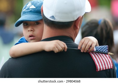 WASHINGTON, DC - MAY 1: Nelson Navidad holds his son Nelson Jose, 4, at a rally of immigrants and supporters calling for legal reforms and an end to workplace raids May 1, 2009 in Washington, DC.