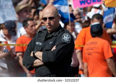 WASHINGTON, DC - MAY 1: Police confront crowds of immigration reform activists during a protest on May 1, 2010  at the White House in Washington, DC.