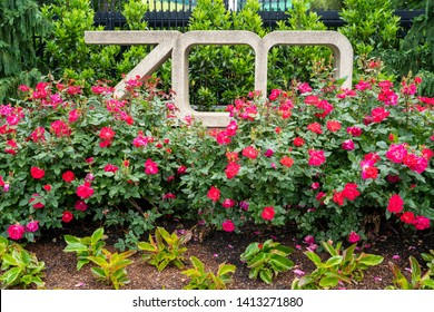 Washington DC - May 11, 2019: Sign for the Smithsonian National zoo, flowers surround the sign